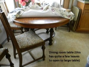 dining room table has a lot of leaves