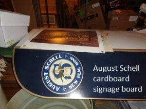 August Schell cardboard sign