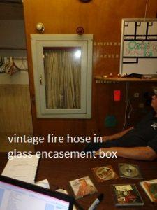 vintage fire hose in glass encasement